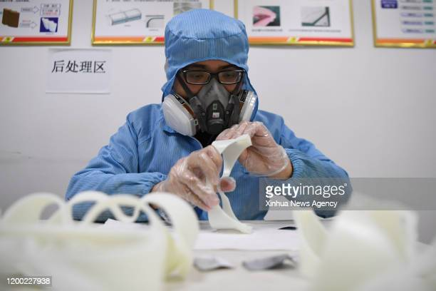 Feb. 11, 2020 -- A worker polishes the spectacle frame of a pair of goggles made by 3D printer at the additive manufacturing research and application...