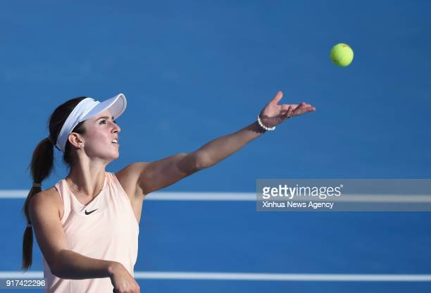Catherine Bellis of the United States serves during the single's first round match against Daria Kasatkina of Russia at the 2018 WTA Qatar Open in...