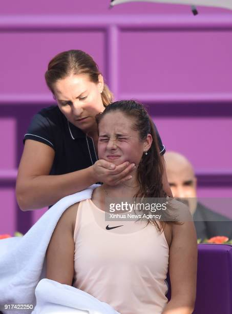Daria Kasatkina of Russia receives medical treatment during the single's first round match against Catherine Bellis of the United States at the 2018...