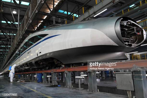 Feb. 12, 2020 -- Maintenance worker Zhang Zewei disinfects the filter of the air-conditioner of a train at Zhengzhou high-speed railway maintenance...