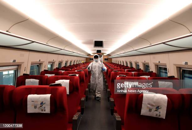 Feb. 12, 2020 -- Staff disinfect a carriage on a high-speed train at Zhengzhou high-speed railway maintenance station in Zhengzhou, central China's...