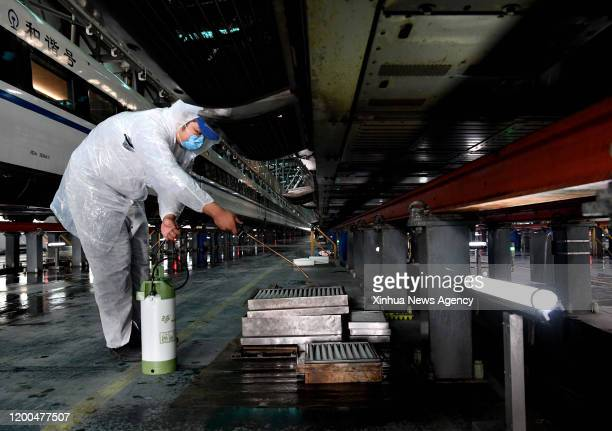 Feb. 12, 2020 -- Staff disinfect the filters of the air-conditioner of a train at Zhengzhou high-speed railway maintenance station in Zhengzhou,...