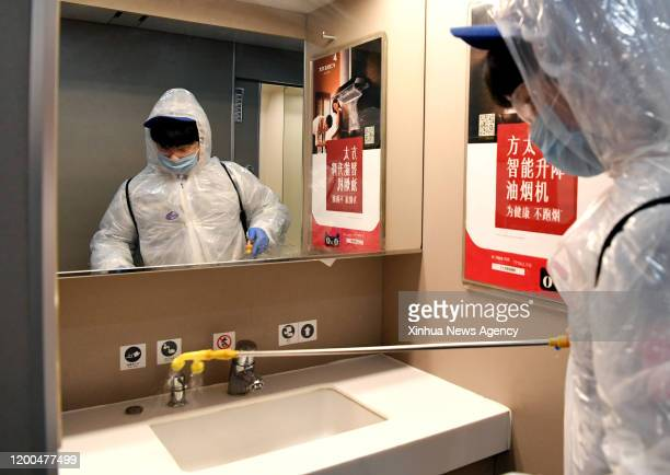 Feb. 12, 2020 -- Staff disinfect the wash basin on a high-speed train at Zhengzhou high-speed railway maintenance station in Zhengzhou, central...