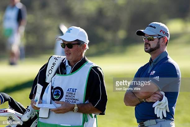 Rory Sabbatini await their turn on the tee box at Spyglass Hill Golf Course during the ATT Pebble Beach National ProAm in Pebble Beach CA