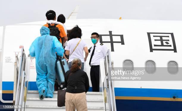 SANYA Feb 13 2020 Tourists from Hubei Province board a plane at Sanya Phoenix International Airport in Sanya south China's Hainan Province Feb 13...