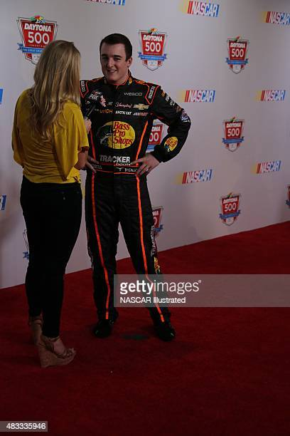 Ty Dillon driver of the Bass Pro Shops Chevy Camaro is interviewed by the media during the 2014 NASCAR Media Day at the Daytona International...