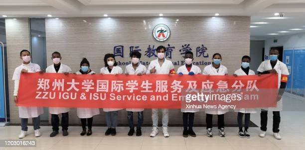Feb. 14, 2020 -- Members of a service and emergency response team formed by international students pose for a group photo at Zhengzhou University in...