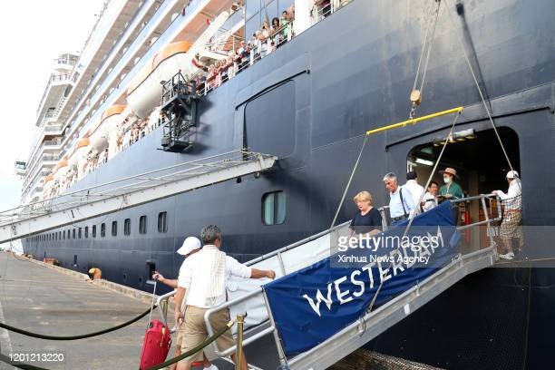 PENH Feb 14 2020 Passengers leave the Westerdam cruise ship at southwest Cambodia's sea port of Sihanoukville on Feb 14 2020 The cruise ship which...