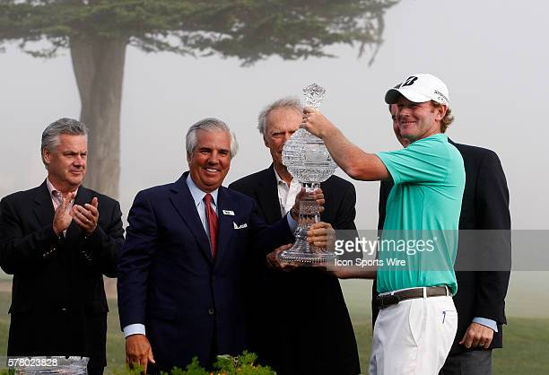 Brandt Snedeker hoists the trophy after winning the ATT Pebble Beach National ProAm in Pebble Beach CA