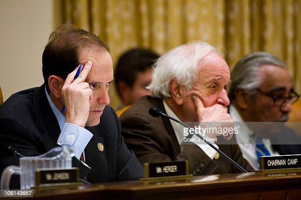 Chairman Dave Camp RMich ranking member Sander M Levin RMich and Rep Charles B Rangel DNY during the House Ways and Means hearing with Treasury...