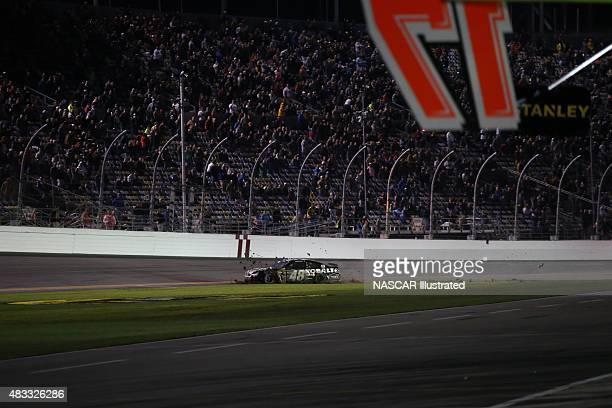 Jimmie Johnson driver of the Lowe's/Kobalt Tools Chevy SS is involved in a crash during the running of the 2014 Sprint Unlimited race at the Daytona...