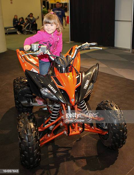 Feb 16 2009- CIAS - Family Day at the Canadian International Auto Show in Toronto. Veronica Nellestein 3yrs. From Mississauga tries out a Yamaha ATV...