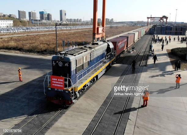Feb. 16, 2020 -- Aerial photo taken on Feb. 16, 2020 shows a China-Europe freight train departing from Zhengzhou Station, central China's Henan...