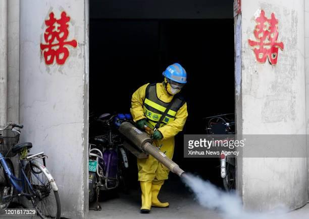 Feb. 16, 2020 -- Volunteer Li Jian, a member of the Zhengzhou Blue Sky Rescue team, conducts a disinfection operation at a community in Zhengzhou,...