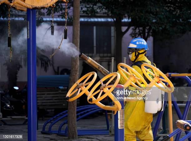 Feb. 16, 2020 -- Volunteer Li Jian, a member of the Zhengzhou Blue Sky Rescue team, disinfects public facilities at a community in Zhengzhou, central...
