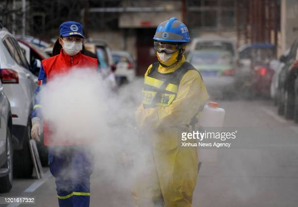 Feb. 16, 2020-- Volunteer Li Jian R and his wife Huang Jun, both members of the Zhengzhou Blue Sky Rescue team, conduct a disinfection operation at a...