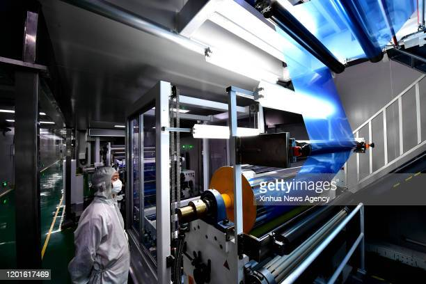 NANYANG Feb 17 2020 A worker makes medical dry imaging film at the workshop of Clear Technology Co Ltd in Nanyang central China's Henan Province Feb...