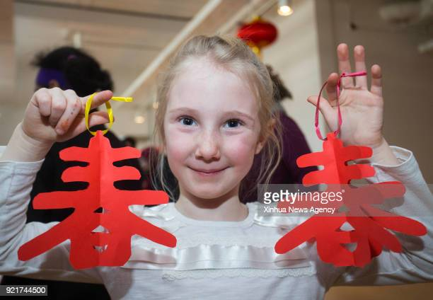 TORONTO Feb 18 2018 A girl poses for photos with papercut crafts during the 2018 Toronto Happy Chinese New Year Reception Family Day Weekend event at...