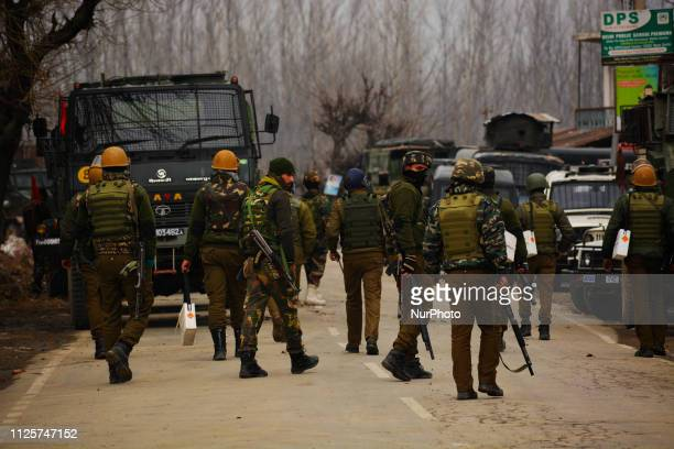 Feb 18 2019 Pulwama Jammu And Kashmir India Indian paramilitary trooper stand alert near the gun battle site in Pulwama south of Srinagar the summer...