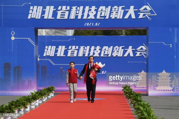 Feb. 18, 2021 -- Xiao Gengfu R, a researcher of the Wuhan Institute of Virology, under the Chinese Academy of Sciences, walks on the red carpet ahead...