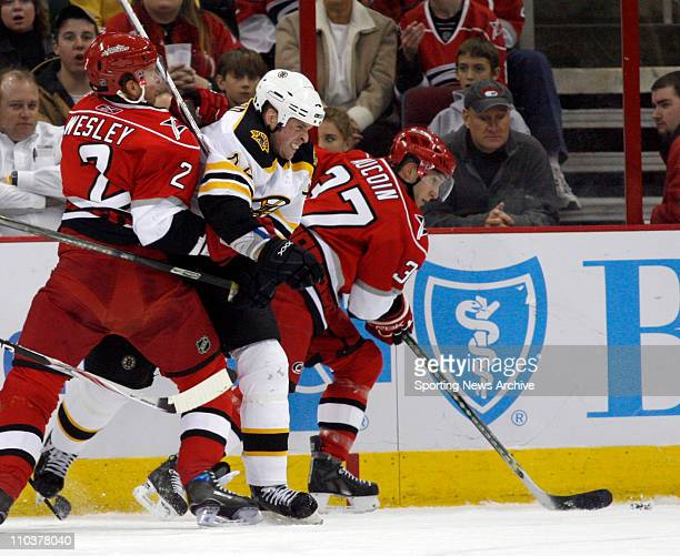 Feb 19 2008 Raleigh North Carolina USA NHL Ice Hockey Boston Bruins AARON WARD against Carolina Hurricanes GLEN WESLEY AND KEITH AUCOIN on Feb 19...