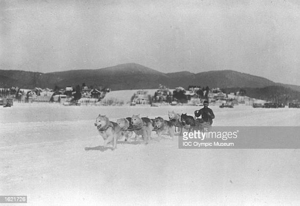 A competitor in action during the Dog Sled Racing event at the 1932 Winter Olympic Games in Lake Placid New York State USA Mandatory Credit IOC...