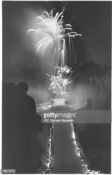 Fireworks explode above the big ski jump tower during the Closing Ceremony of the 1936 Winter Olympic Games in Garmisch-Partenkirchen, Germany. \ Mandatory Credit: IOC/Olympic Museum /Allsport