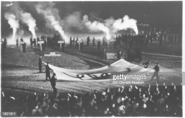 The Olympic flag is taken down during the Closing Ceremony of the 1936 Winter Olympic Games in Garmisch-Partenkirchen, Germany. \ Mandatory Credit: IOC/Olympic Museum /Allsport