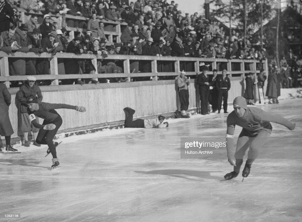 The Winter Olympics at Garmisch-Partenkirchen. The 1500m speed skating event with, left, de Ligne (BEL) and the Norwegian Haraldsen. Mandatory Credit: Allsport Hulton/Archive