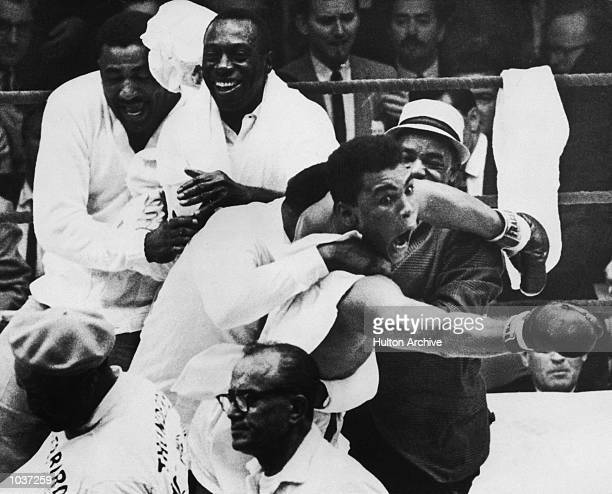 Cassius Clay flies around the ring after beating Sonny Liston in the seventh round of the World Heavyweight Title bout in Miami Beach, Florida, USA....