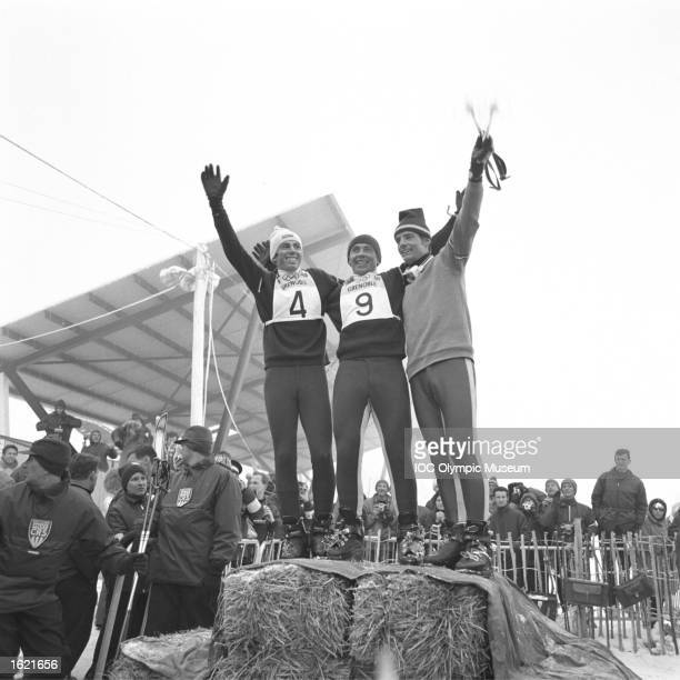 Herbert Huber of Austria Karl Schranz of Austria and JeanClaude Killy of France standing on straw bales enjoying a moment between events during the...
