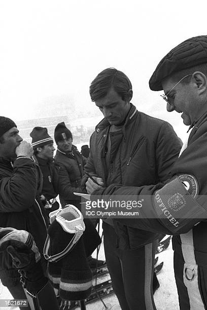 JeanClaude Killy of France signing an autograph between events during the 1968 Winter Olympic Games in Grenoble France Mandatory Credit IOC Olympic...