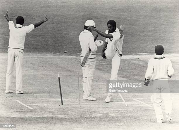 Michael Holding of the West Indies kicks over the stumps in frustration after a decision for caught behind is turned down during the First Test match...