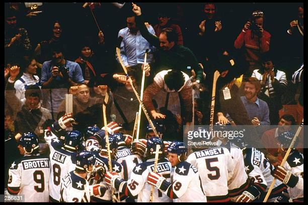 The USA Team celebrates their 4-3 victory over Russia in the semi-final of the Ice Hockey competition of the 1980 Winter Olympic Games in Lake...