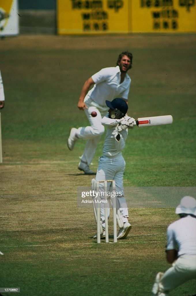 Ian Botham of England and Sidath Wettimuny of Sri Lanka : News Photo