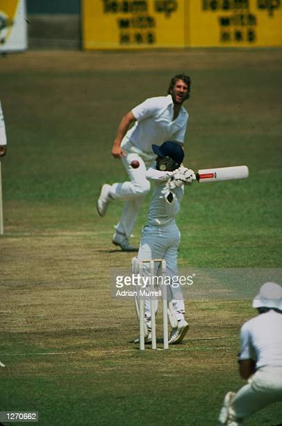 Ian Botham of England bowls a bouncer to Sidath Wettimuny of Sri Lanka during the Only Test match at P Saravanamuttu Stadium in Colombo Sri Lanka...