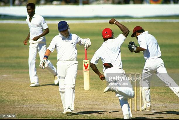 The West Indies celebrate as Michael Holding captures Paul Downton of England during the First Test match at Sabina Park in Kingston Jamaica The West...