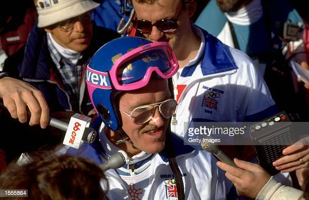 Eddie Edwards of Great Britain is surrounded by the press after the 90 metres Ski Jump event at the 1988 Winter Olympic Games in Calgary, Canada....