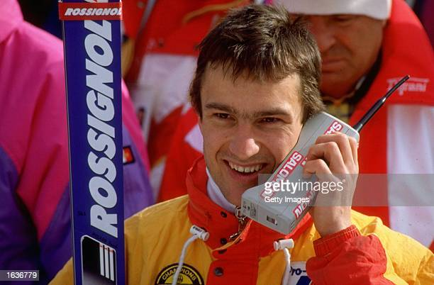 Franck Piccard of France talks on his mobile phone after the Mens Super G Slalom event at the 1988 Winter Olympic Games in Calgary Canada Piccard won...
