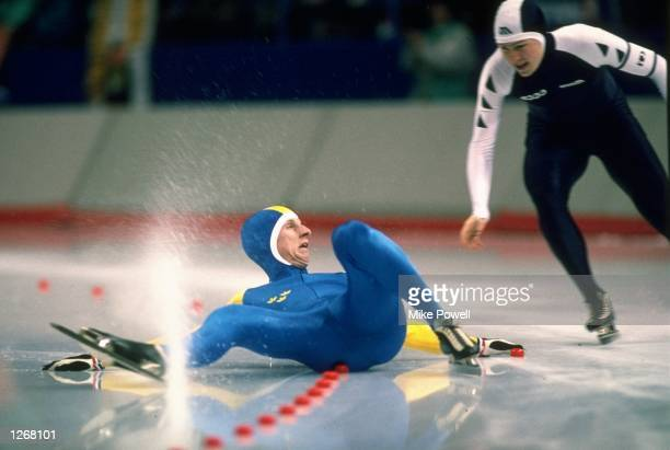 Karlberg of Sweden falls as Bobrov of the USSR goes past during the 1500 metres Speed Skating event at the 1988 Winter Olympic Games in Calgary...