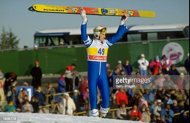 Matti Nykanen of Finland holds his skies aloft after the 90 metres Ski Jump event at the 1988 Winter Olympic Games in Calgary Canada Nykanen won the...
