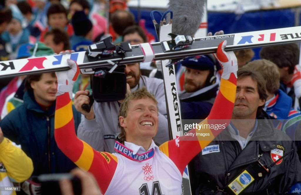 Pirmin Zurbriggen of Switzerland raises his skies aloft after the Mens Downhill event at the 1988 Winter Olympic Games in Calgary, Canada. Zurbriggen won the gold medal with a time of 1:59.63 minutes. \ Mandatory Credit: Allsport UK /Allsport