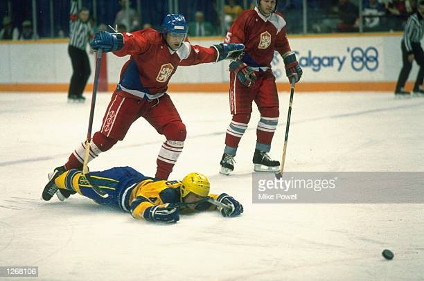 Thom Eklund of Sweden lies on the ice during the Ice Hockey match against Czechoslovakia at the 1988 Winter Olympic Games in Calgary Canada Mandatory...