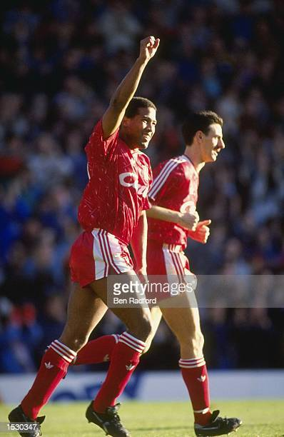 John Barnes of Liverpool and teammate Ian Rush acknowledge the crowd after a goal in the derby match against Everton at Anfield in Liverpool....