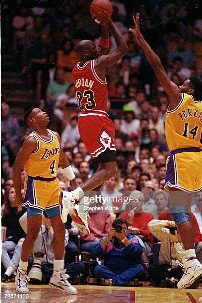 Feb 1991: Michael Jordan of the Chicago Bulls shoots over Sam Perkins and Byron Scott of the Los Angeles Lakers on February 3, 1991 at the Great...