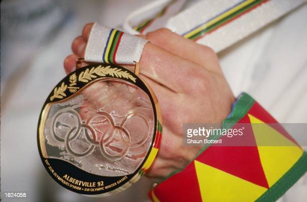 Competitor shows off a gold medal during the Winter Olympic Games in Albertville, France. \ Mandatory Credit: Shaun Botterill/Allsport