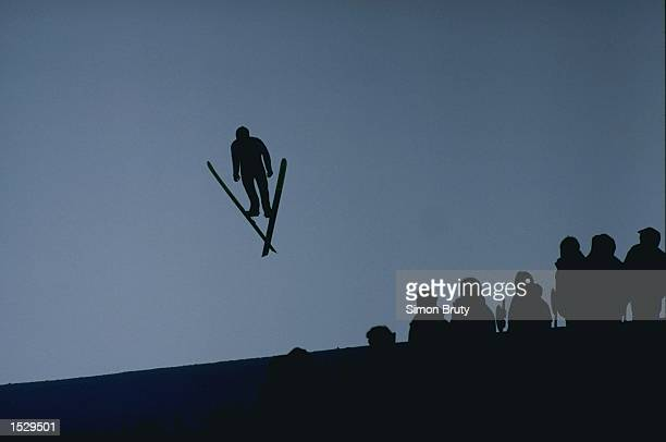 Ski jumper in action during the men's team ski jumping competition at the 1992 Winter Olympic Games in Albertville, France. \ Mandatory Credit: Simon...