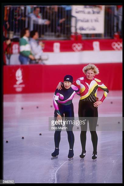 B Qiaobo of China and M Garbracht of Germany skate together during the 1000 meter speed skating competition at the Olympic Games in Albertville...