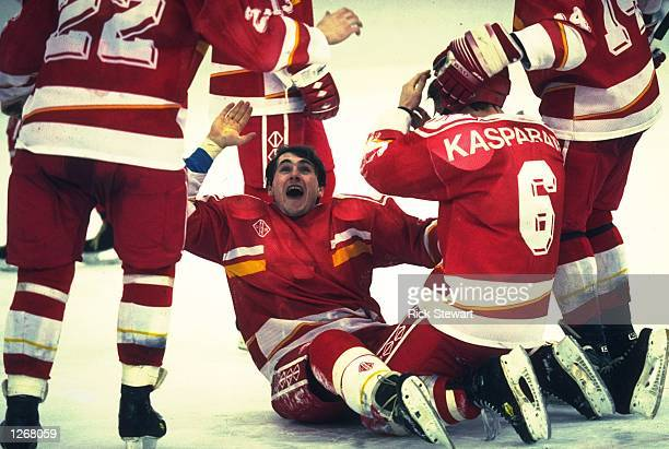 Dritori Youshkevitch of the Unified Team celebrates after his team win the gold medal in the Ice Hockey match against Canada during the 1992 winter...