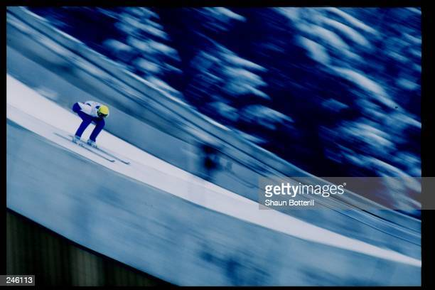 General view of a competitor in the men''s team 120 m ski jump event during the Winter Olympics in Albertville, France.